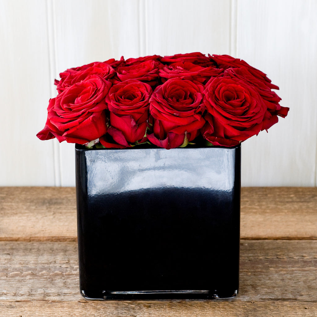 Image of Grand Prix red roses in a black cube vase