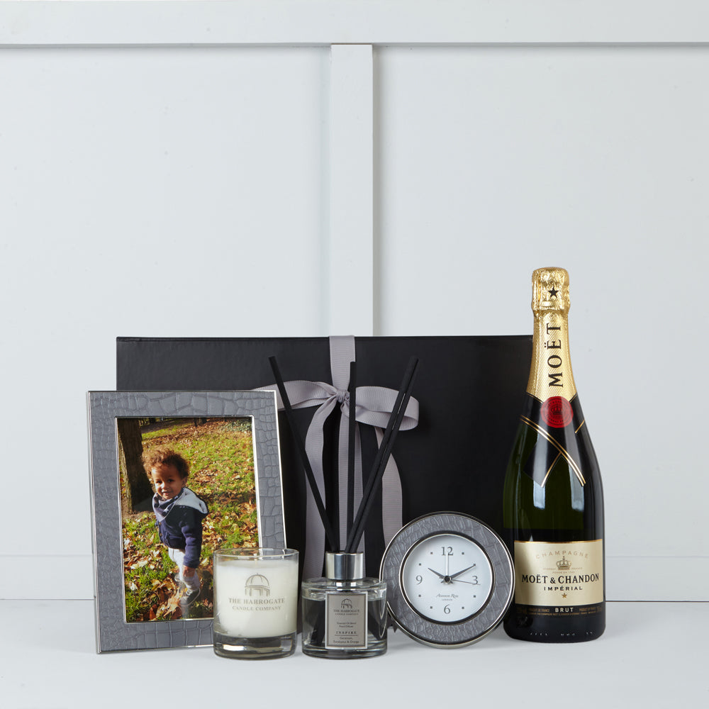 Image of faux crocodile clock & photo frame by Addison Ross. scented candle & diffuser by The Harrogate Candle Company & Moet et Chandon champagne