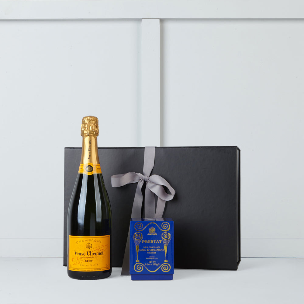 Bottle of Veuve Cliquot champagne and marc de champagne truffles by Prestat