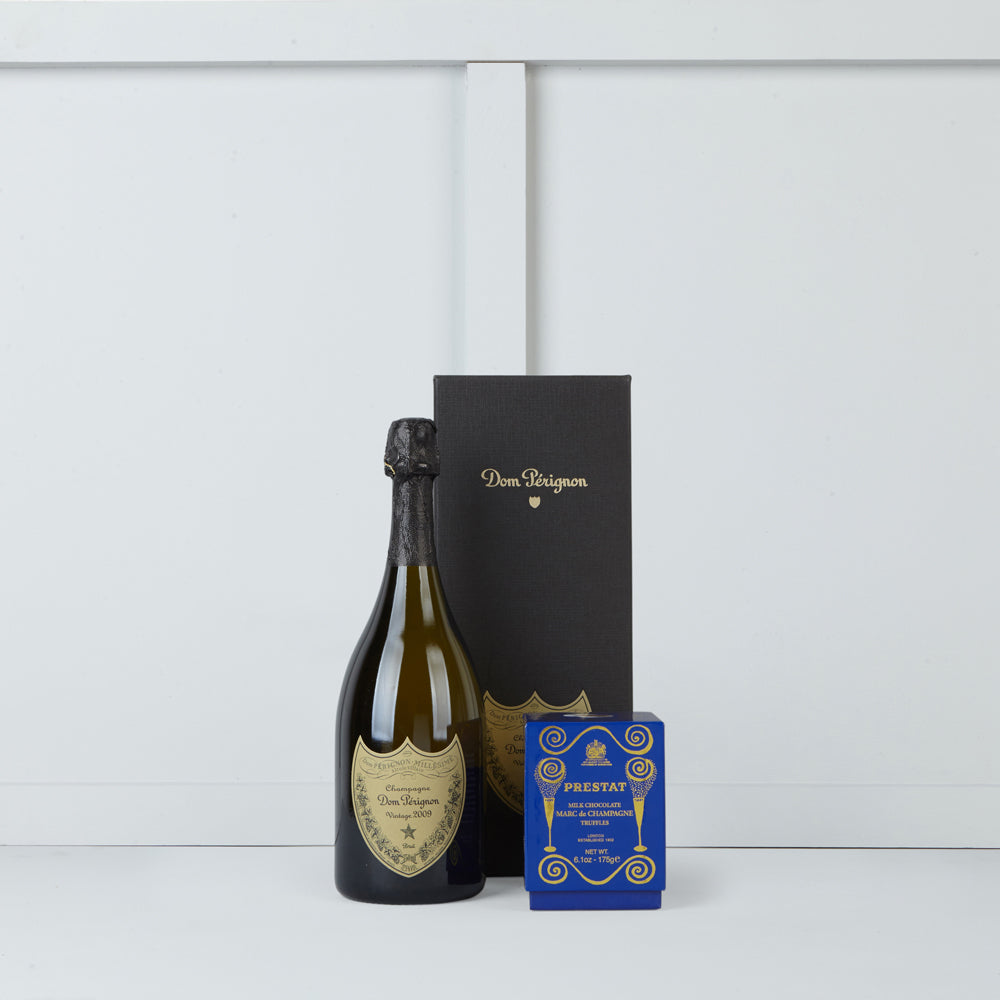 Image of bottle of Dom Perignon & box of Prestat Marc de Champagne Truffles