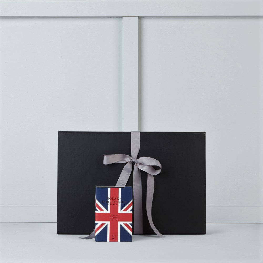Image of book style Union Jack box filled with British selection chocolates by House of Dorchester