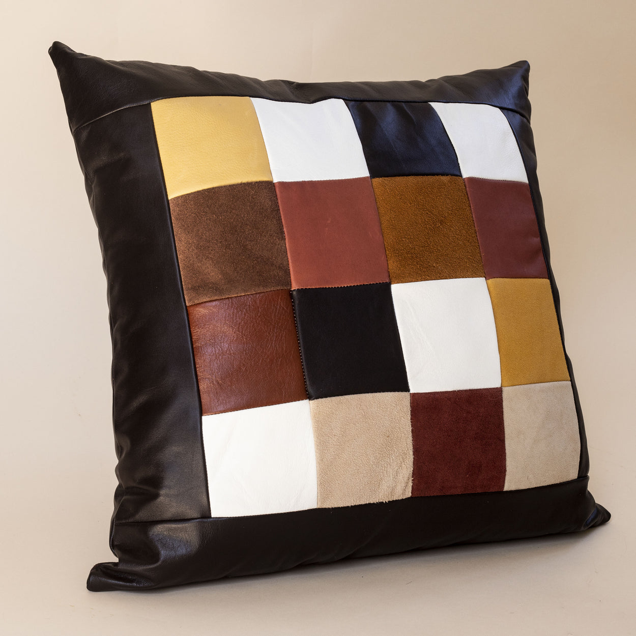 patchwork recycled leather pillow handmade by storyteller studio in Louisville KY