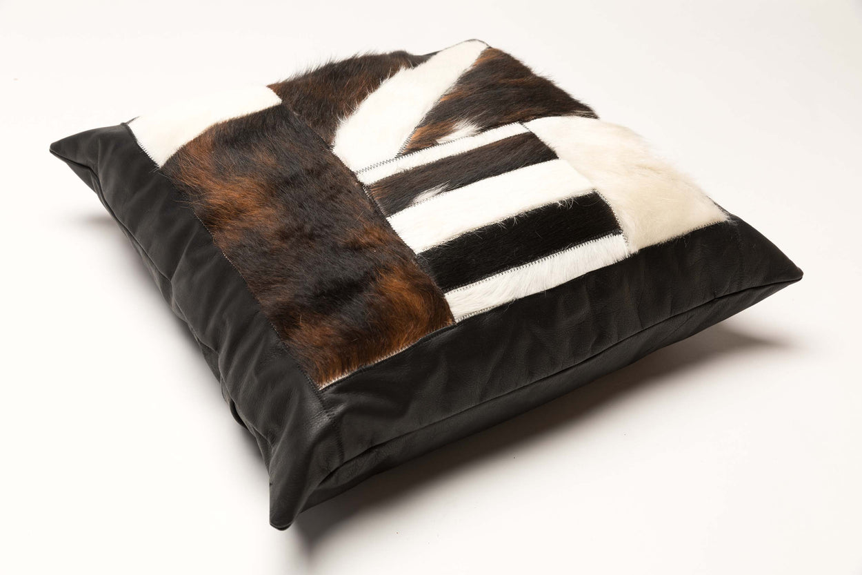 patchwork genuine cowhide pillows laying on its side