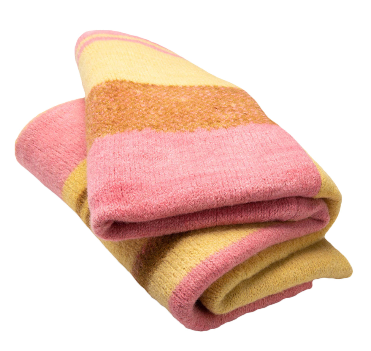 folded pink yellow and brown Alpaca blanket knitted by storyteller studio against white background