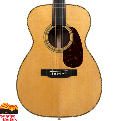 Sunrise Guitars in Fayetteville, Arkansas is proud to carry the Martin 00-28 acoustic guitar. The rich sound of authentic East Indian rosewood and Sitka spruce, bound in bold herringbone with vintage appointments. Resonant scalloped bracing make natural harmonics and woody tone bloom with every note.