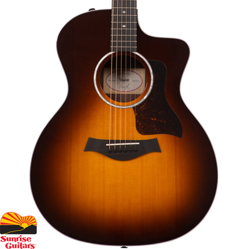 Sunrise Guitars in Fayetteville, Arkansas is proud to carry the Taylor 214ce Sunburst Deluxe acoustic guitar. A rich tobacco sunburst finish brings a touch of vintage warmth to this Grand Auditorium guitar, giving it a unique visual flavor to complement its full-bodied sound.