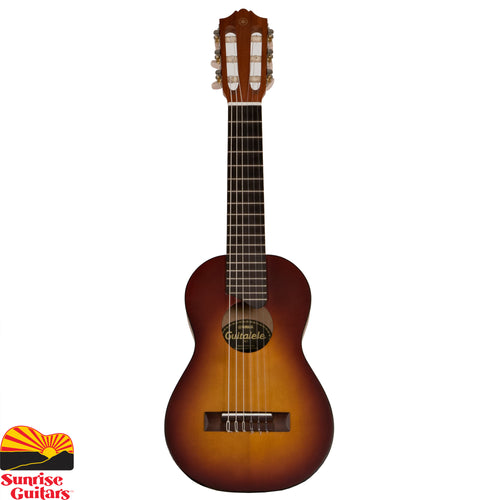 "Sunrise Guitars in Fayetteville, Arkansas is proud to carry the Yamaha GL1 Tobacco Sunburst guitalele. Introducing the Yamaha GL1 Guitalele, now officially available for the first time in the USA! Half guitar, half ukulele…100% fun. A unique mini 6-string nylon guitar that is sized like a baritone ukulele (17"" scale) and plays like a standard tune guitar."