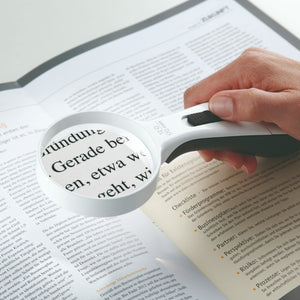 ERGO Lux magnifier reading magnified image of book