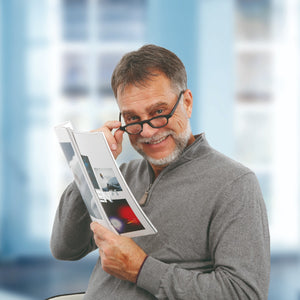 man wearing improvision spectacles reading brochure