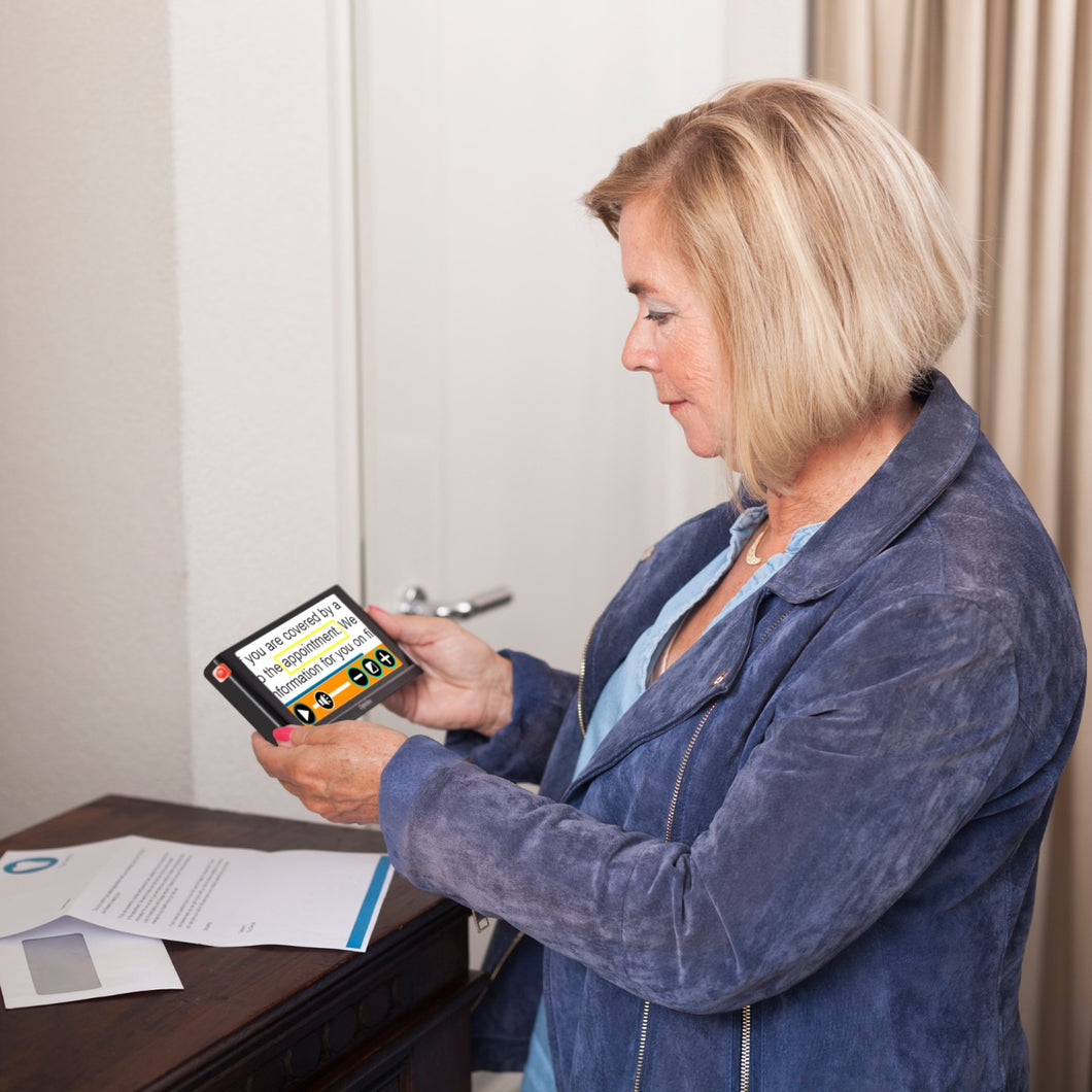 mature woman using compact 6 speech to read mail aloud