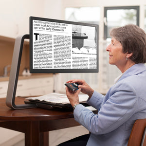 mature woman adjusting magnification on clearview c