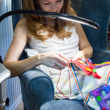 young woman using stella edge task lamp