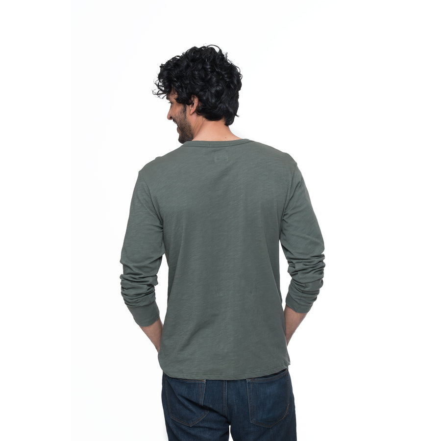 Front view of model wearing Adam in dark green