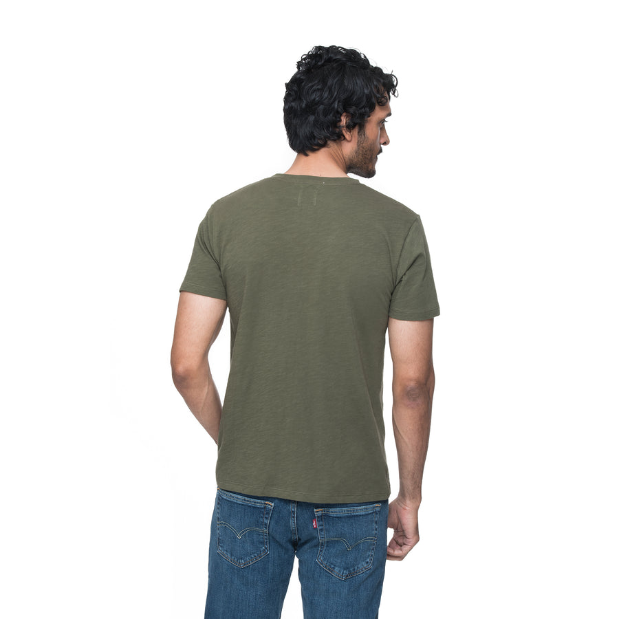 Front view of model wearing Rich in dark sea green