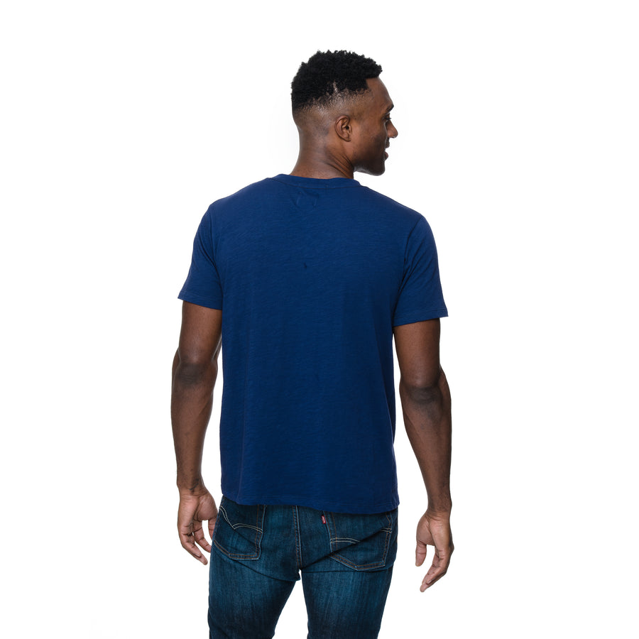 Front view of model wearing the Henry tee in blue velvet