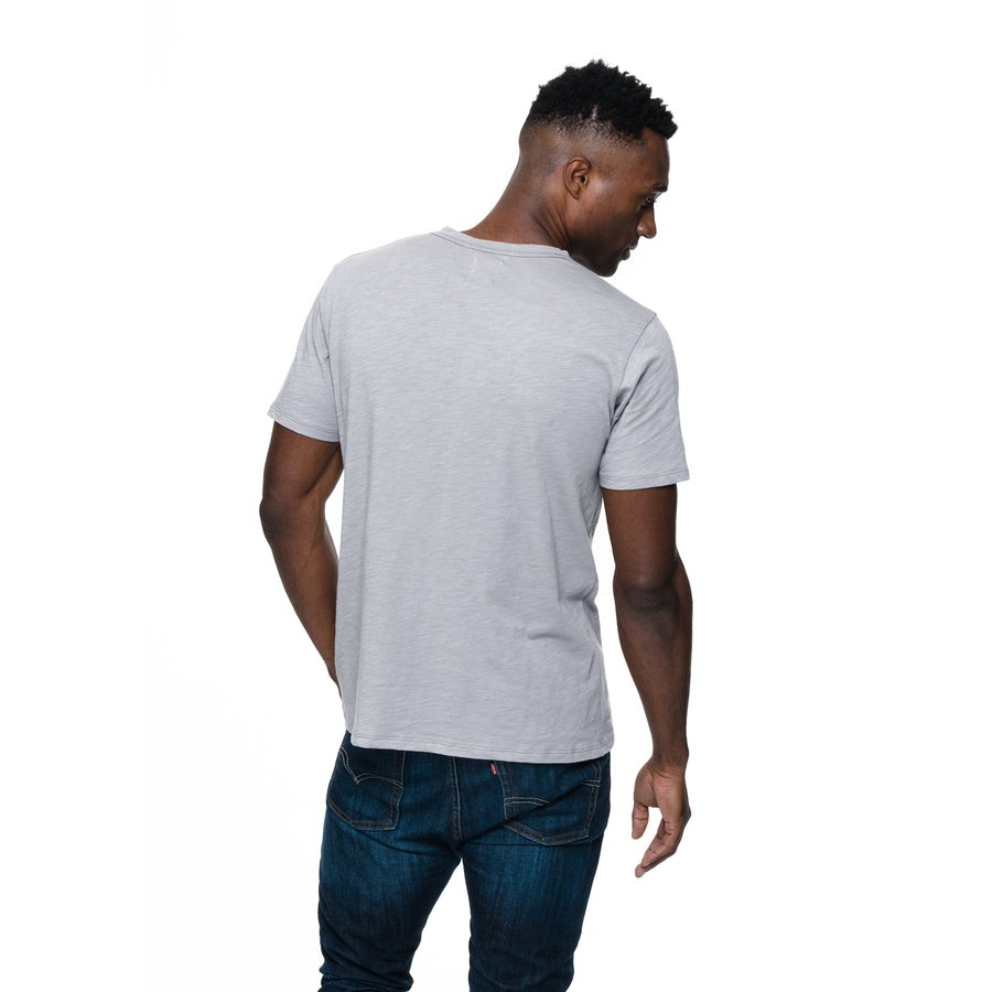 Front view of model wearing Rich in grey