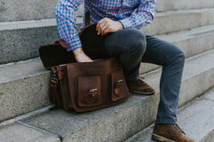 Opening a Leather Briefcase Bag sitting on steps