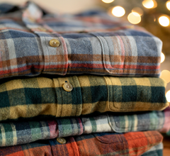 A stack of flannel shirts.