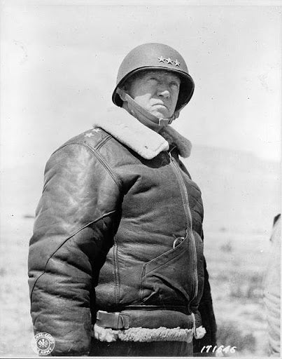 general patton wearing leather brown bomber jacket.