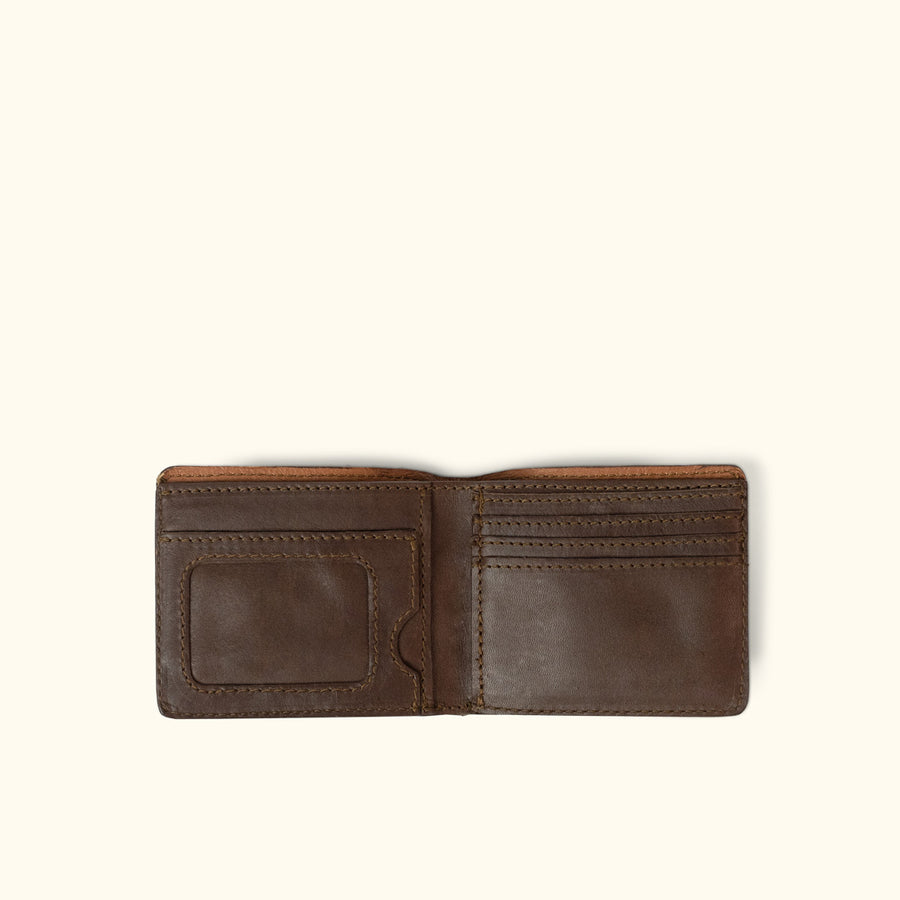 This classic billfold wallet, handcrafted from true leather. Made for men, hand stitched, and crafted with quality.