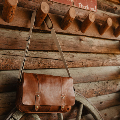 rustic leather messenger bag for laptops and commuters