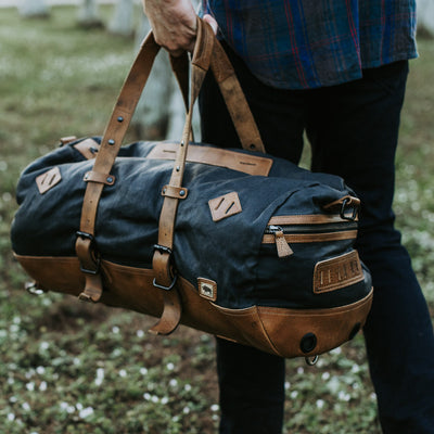 Rugged Waxed Canvas Travel Duffle Bag/Backpack | Navy Charcoal w/ Saddle Tan Leather