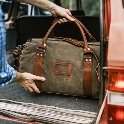 Elkton Waxed Canvas Travel Duffle Bag | Moss w/ Autumn Brown Leather hover