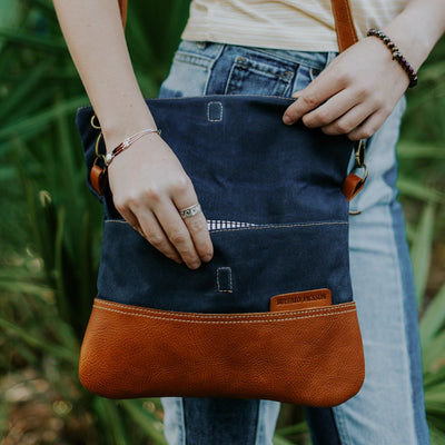 Madison Waxed Canvas Crossbody Foldover Clutch | Navy w/ Saddle Tan Leather hover
