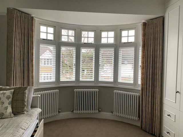 Beautiful Shutters and Curtains in the Living Room