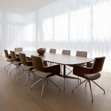 Commercial meeting room scene with bright clean window and blinds