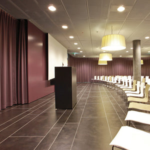 Silent Gliss Curtain tracks used in a commercial lecture theatre room setting.