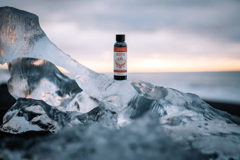 American Provenance Natural Beard Oil in Fastballs & Fisticuffs scent, sitting on ice