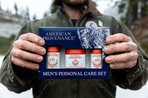 Man holding American Provenance Men's Personal Care Set in Fastballs & Fisticuffs Scent