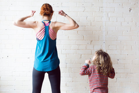 healthy mother and daughter excersising