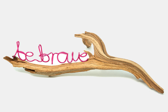 Motivational desk art made of driftwood