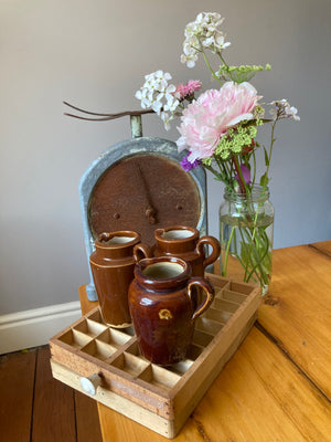 Set of three mini brown ceramic jugs