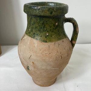 Rustic green pitcher