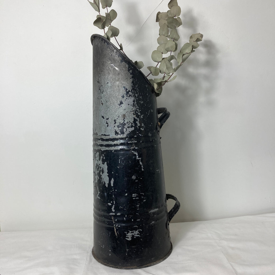 Large black rustic pitcher