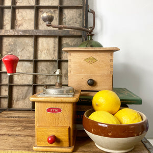 Kym wooden and red coffee grinder