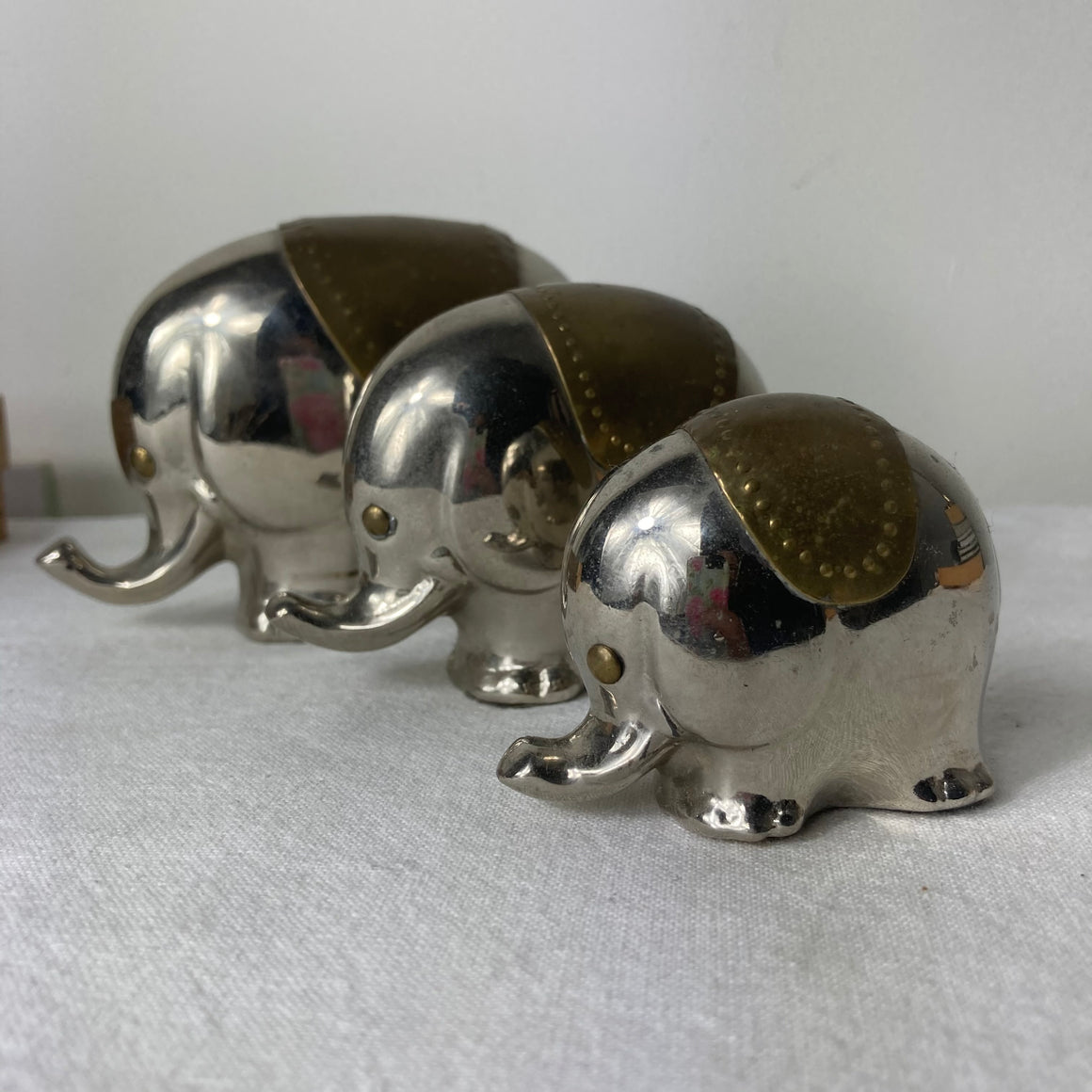 Set of three metal elephant ornaments