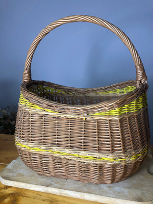 Wicker basket with yellow stripe