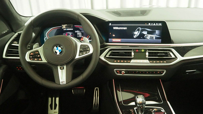 products/BitCars-bmw-x7-m50d-1-with-bitcoin.jpg