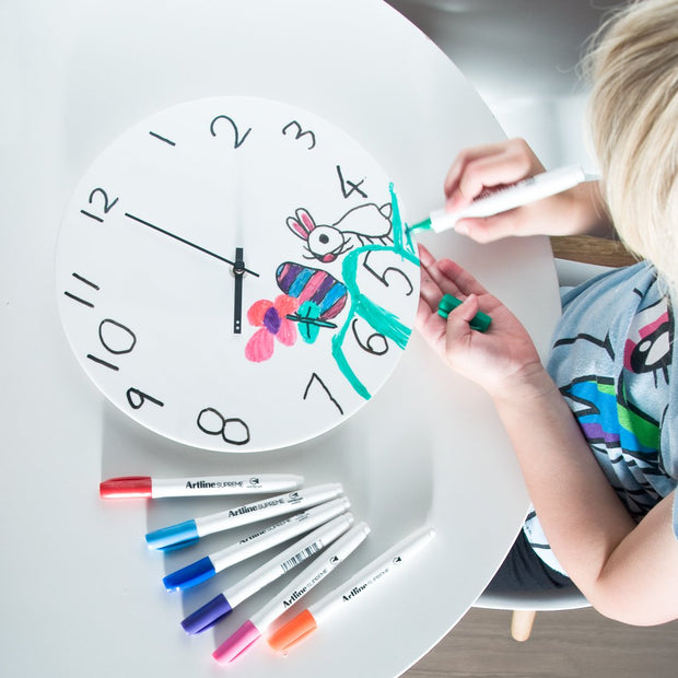 TOO designs TOO-do whiteboard wall clock with child learning to read and write time