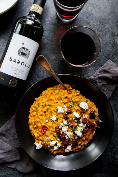 pumpkin risotto with goat cheese and dried cranberries paired with barolo wine