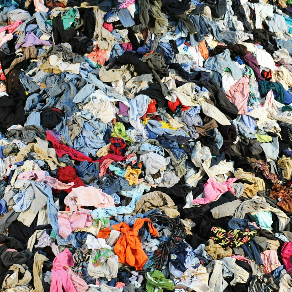 How Can You Protect The Environment By Buying Luxury Handbags: Pre-Loved Luxury and Sustainability pile of clothes