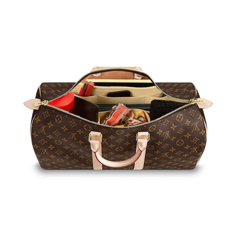 What Size Louis Vuitton Keepall Should I get? what fits in a Keepall