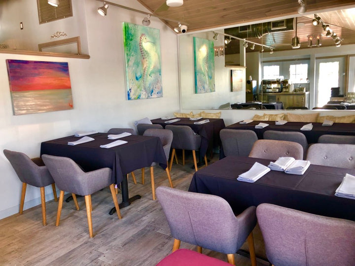 Sunshine Seafood Café and Wine Bar featuring art by Lacy McClary.