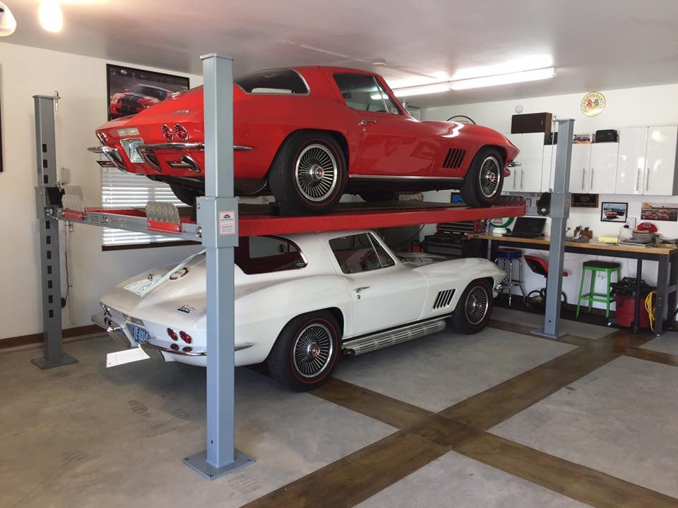 Advantage Lifts Facebook profile picture showing two Corvettes being stored in a garage with a low ceiling.