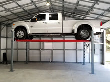 11,000 Pound Heavy Duty Advantage Auto Lift lifting a truck at max height