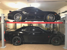 Side profile of Advantage auto lift supporting Porsche and Dodge high-end vehicles